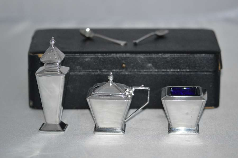 A stylish Cased Art Deco silver condiment set, H Quibell & Son, Birmin