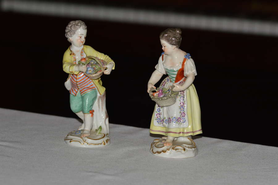 Early 20th century pair of Meissen figurines of a boy and girl