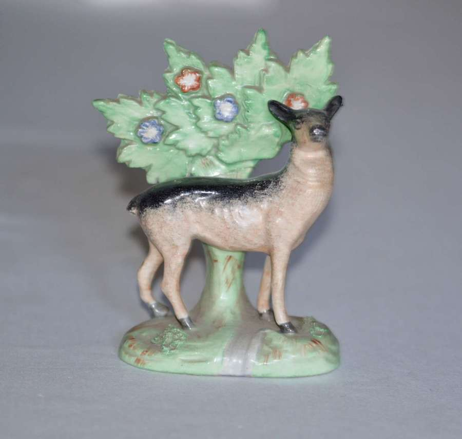 A 19th Century Staffordshire model of a Black and Tan Deer