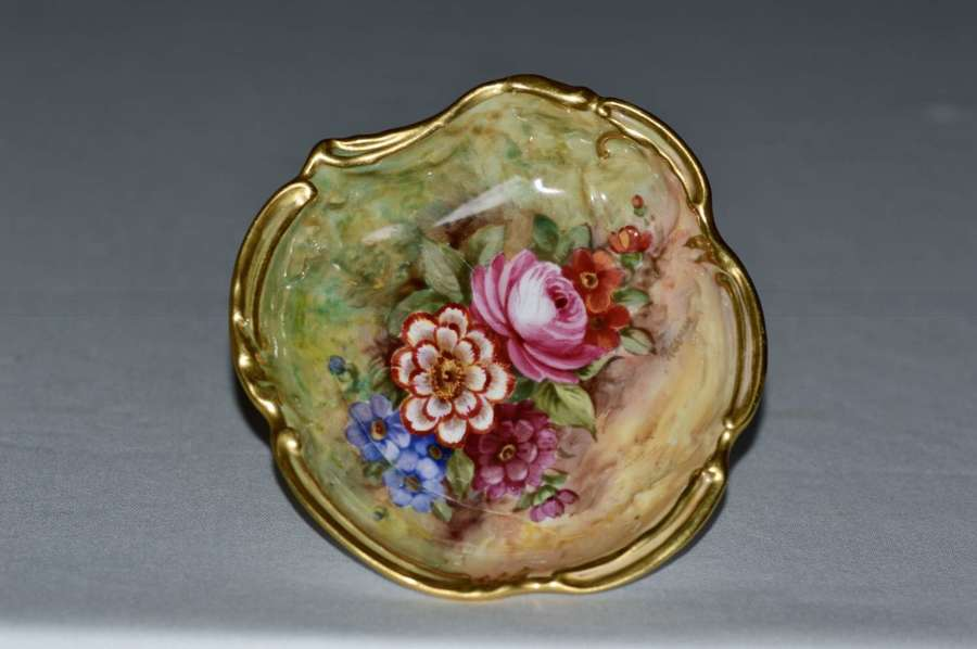 A 1935 Royal Worcester dish, flowers on mossy ground, signed J Freeman